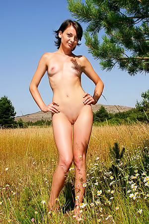 Flowers, grass, nature and fun being naked outside