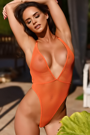 Adele Taylor In Orange Bodysuit