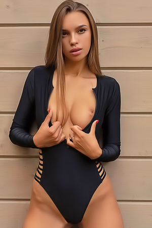 Alina strips her dark blue bodysuit outdoor