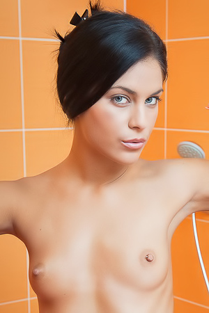 Nude woman is masturbating in a shower