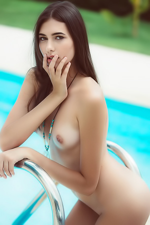 Free spirit Katrine Pirs gets naked by the pool