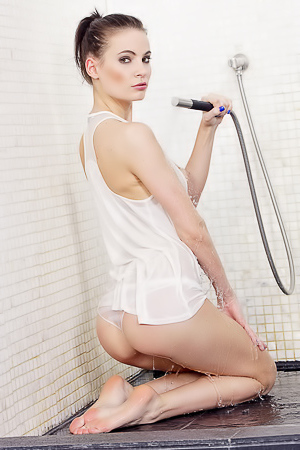 Yummy babe takes hot shower