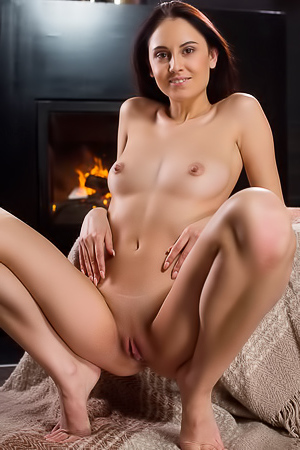 Brunette relaxes on a solo date at the fireplace