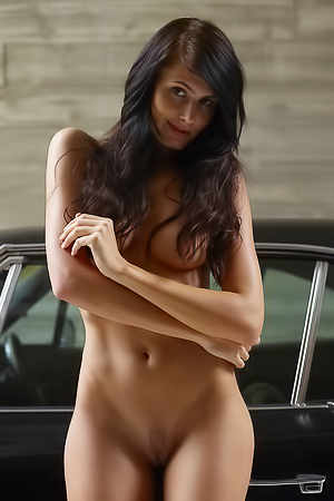 Raunchy woman strips by the car