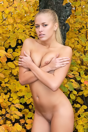 Nude woman outdoors in autumn