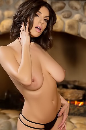 Darcie Dolce gets hot, horny, and naked by the fire